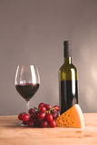 On the table a bottle of wine and a glass of.  royalty free stock photography