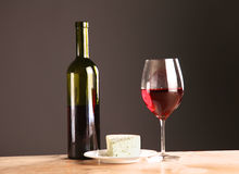 On the table a bottle of wine and a glass of.  royalty free stock photos