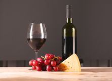 On the table a bottle of wine and a glass of.  stock image