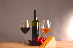 On the table a bottle of wine and a glass of.  stock images
