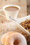 Breakfast Table. Table Breakfast - Continental Breakfast, coffee and donuts Stock Image