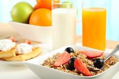 Breakfast Table. Table Breakfast - Continental Breakfast, fruit, cereals and orange juice Stock Images