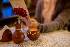 Table in cafe with flower and candle Royalty Free Stock Photography