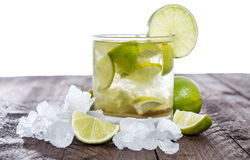 Table with Caipirinha on white Royalty Free Stock Photo