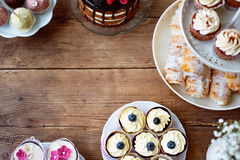 Table with cake, cupcakes, cakepops and horn pastries. Copy spac Stock Photography