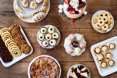 Table with cake, pie, cupcakes, cookies, tarts and cakepops Royalty Free Stock Images