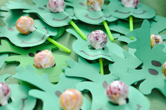 Table with candies and decorations Royalty Free Stock Images