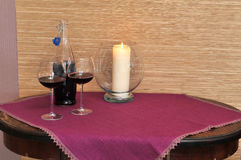 Table with candle and wine Royalty Free Stock Image