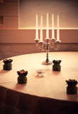 Table with candles Stock Images