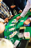Table with casino players Stock Photography