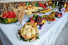 Table catering with different fruits such as watermelon, pineapp Royalty Free Stock Images