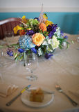 Table centerpiece. Flowers centerpiece at wedding reception table, shallow DOF focus on bouquet Royalty Free Stock Photos