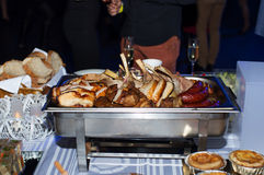 Table with chafing dish Royalty Free Stock Image