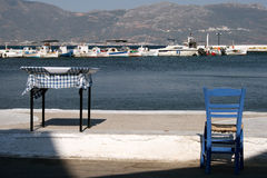 Table and chair. A table and a chair outside of a restaurant on a Greek island Stock Photo
