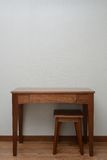 Table and chair in bedroom Stock Photo