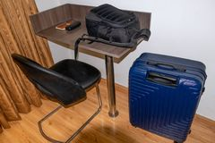 Table chair with carry bag and suitcase inside the room royalty free stock photos