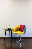 Table Chair combination in front of a plain wall Stock Photos