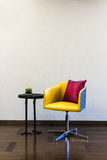 Table Chair combination in front of a plain wall Royalty Free Stock Image