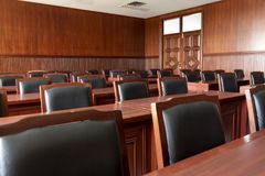 Courtroom of the judiciary. Table and chair in the courtroom of the judiciary stock image