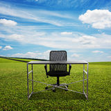 Table and chair on the meadow Royalty Free Stock Photos