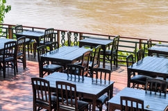 Table and chair outdoor riverside dinner Stock Images