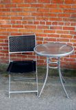 Table and chair outside of coffee shop. Royalty Free Stock Photo