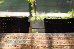 Table and chair at patio with garden background Royalty Free Stock Images