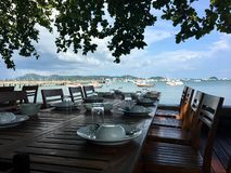 Table and chair at restaurant sea view. Dinner , sea foods royalty free stock photography