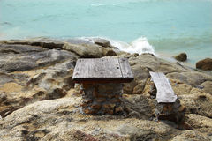 Table and chair on the rock Royalty Free Stock Image