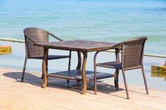 Table chair beside sea Stock Photos