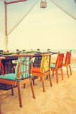 Table and chair set on the beach for dinner Royalty Free Stock Photos
