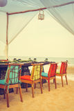 Table and chair set on the beach for dinner Royalty Free Stock Photo