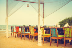 Table and chair set on the beach for dinner Stock Photography