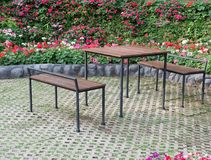 Table and chair set in the flower garden. Royalty Free Stock Photo
