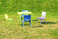 Table chair set on green grass lawn Royalty Free Stock Photos