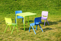 Table chair set on green grass Stock Image