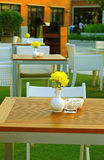 Table and chair setting in outdoor restaurant Stock Photo