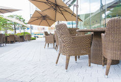 Table and chair with  umbrella outdoor patio Royalty Free Stock Image