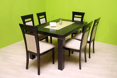 Table and chairs. On green background Stock Photos