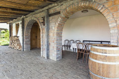 Table and chairs at the back of a winery.  Stock Image