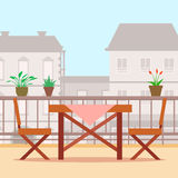 Table and chairs on the balcony. Royalty Free Stock Image
