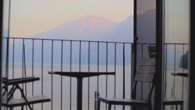 Table and chairs on the Balcony i stock footage