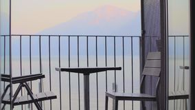 Table and chairs on the balcony stock footage