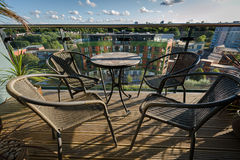 Table and chairs on balcony Royalty Free Stock Photos