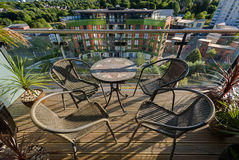 Table and chairs on balcony Royalty Free Stock Photography