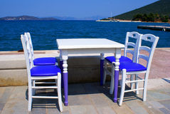 Table and chairs at the beach Royalty Free Stock Photography