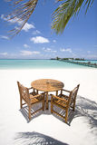 Table and chairs on beach. Table and chairs on exotic beach Royalty Free Stock Photo