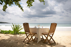 Table and chairs on a beach Stock Photo