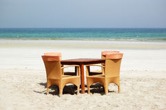 The table and chairs on beach of the luxury hotel Stock Photography