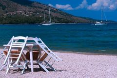 Table and chairs on the beach, Greece Stock Images